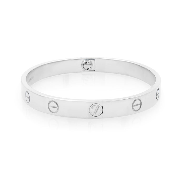The famous Cartier Love bracelet in 18K white gold. Size 17. Width: 6.1mm. Sold with a screwdriver. Excellent pre-owned condition. Box and papers are not included.