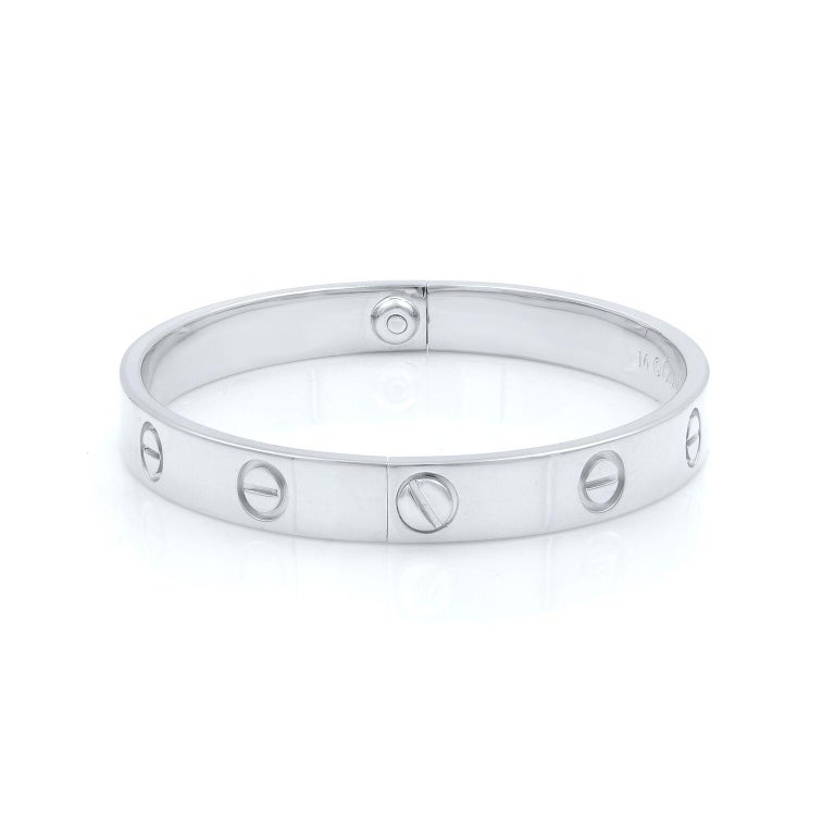 Cartier Love bracelet in 18K white gold. Old screw system. Pre-owned, with old screw style closure. Looks great. Comes with screwdriver and an old original Cartier box. Size: 16