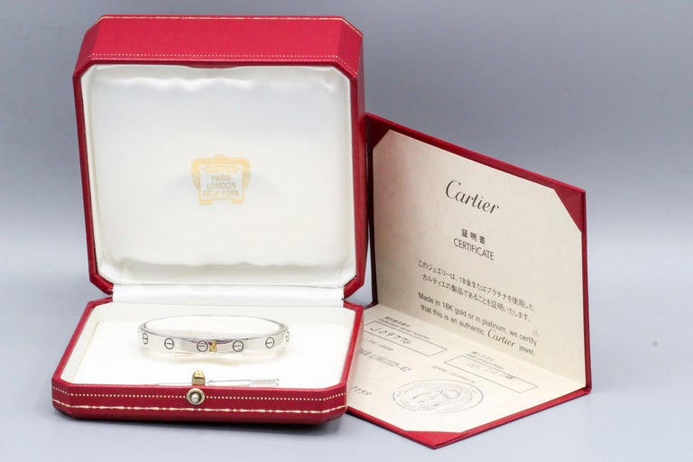 Classic 18k white gold Cartier Love bracelet.  It is a size 16, comes with the screwdriver and box, as well as papers.  Current retail $6750  Hallmarks: Cartier 1993, 750, reference numbers, 16