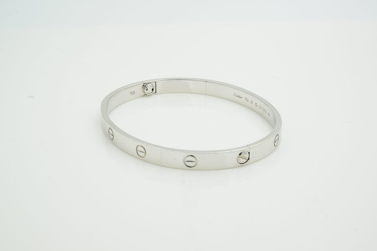100% Authentic Cartier Love Bracelet Size 20 18K White Gold.  Comes with original Cartier box screwdriver but no papers.  Metal Type: 18K Gold Hallmark: 750, Serial Number  Metal Finish: High Polish Collection: Love Condition: Very good.  New screw