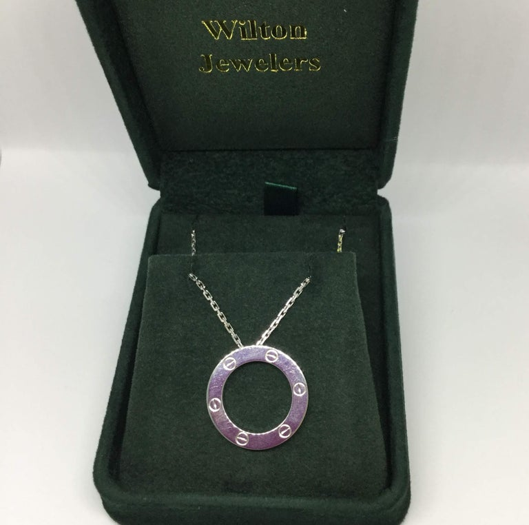 Cartier 18K white gold Love necklace. The inner diameter is 16 mm in width.  The chain is 16 inches in length.