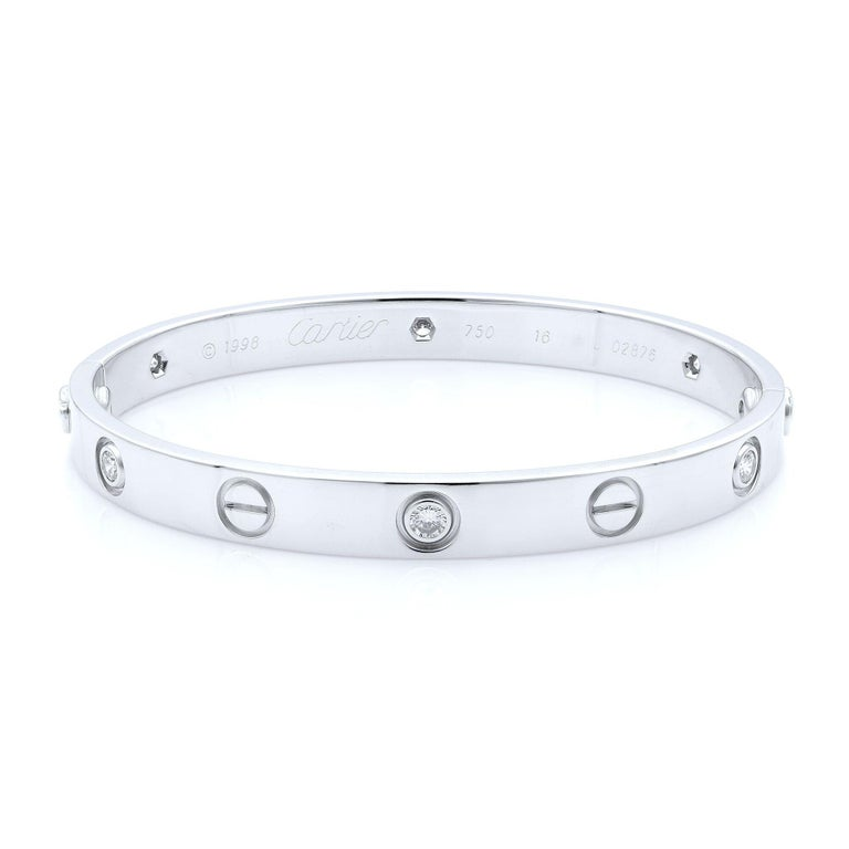 Cartier Love six diamond bangle bracelet in 18K white gold. Old screw system. Pre-owned, with old screw style closure. Looks great. Comes with screwdriver and box, papers are not included. Size: 16