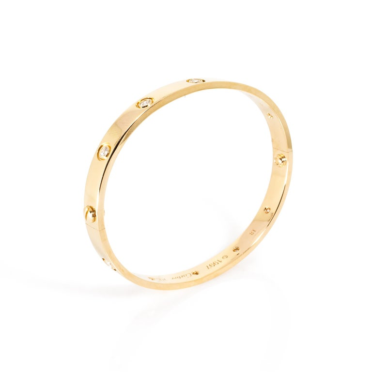 METAL TYPE: 18K Yellow Gold STONE WEIGHT: 0.96ct twd TOTAL WEIGHT: 31.62 grams BRACELET LENGTH: 18 cm
