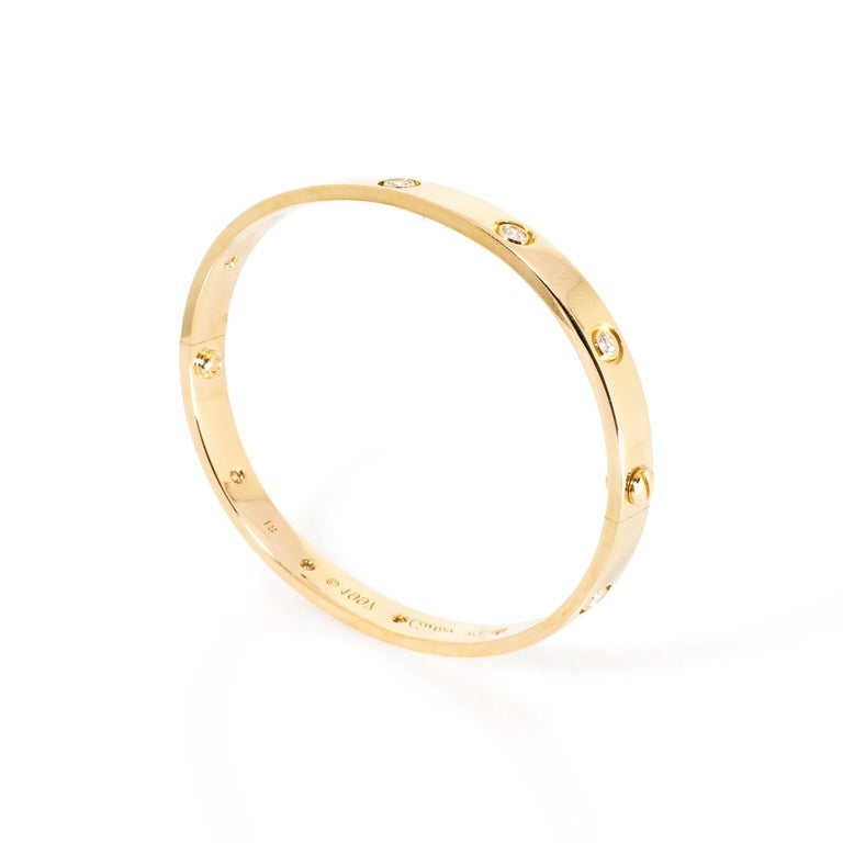 Cartier 18 Karat Yellow Gold 10 Diamonds Love Bracelet In Excellent Condition For Sale In New York, NY