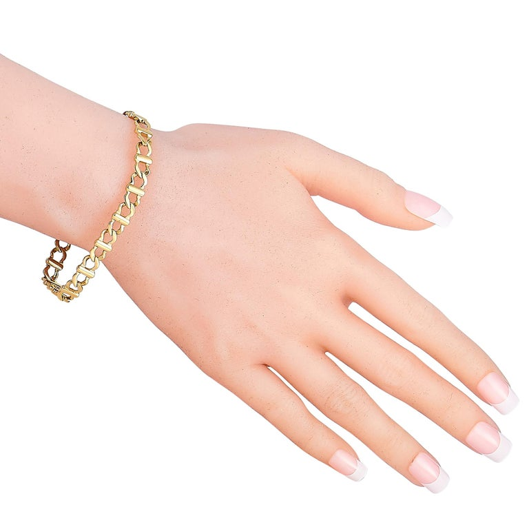 "This Cartier bracelet is made of 18K yellow gold and weighs 18.8 grams, measuring 7"" in length.  The bracelet is offered in estate condition and includes a gift pouch."
