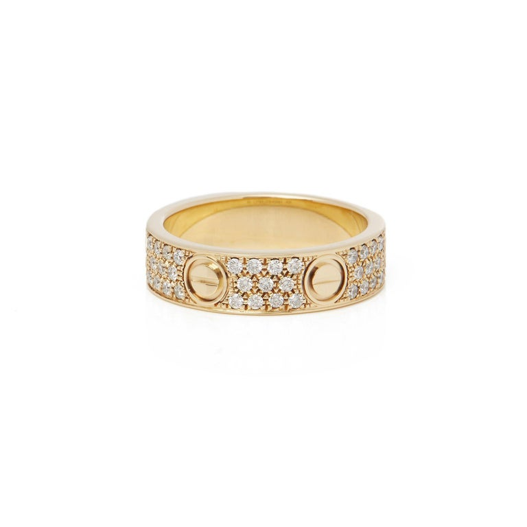 This Ring by Cartier is from their Love Collection and features Sixty Six Round Brilliant Cut Diamonds in a Pave Setting. Set in 18k Yellow Gold. Ring Size UK O 1/2, EU Size 59, USA Size 8 3/4. Complete with Original Presentation Box. Our Xupes