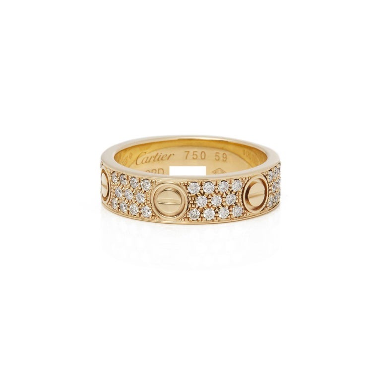 Round Cut Cartier 18 Karat Yellow Gold Diamond Set Love Ring For Sale