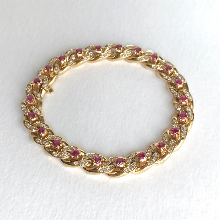 Cartier 18k yellow Gold Gourmet Link Bracelet with 22 Rubies and 132 Diamonds. Each link is set with 1 ruby and 6 Diamonds. With Security. Signed Cartier and Numbered. Hallmark of Eagle. Gross Weight: 41.4g  Length: 18cm Width: 0.8cm