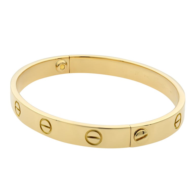 Cartier Love bracelet, 18K yellow gold. Old screw system. Width: 6.1mm. Size 17. Condition: pre-owned, looks great. Comes with a screw driver. Box and papers are not included.
