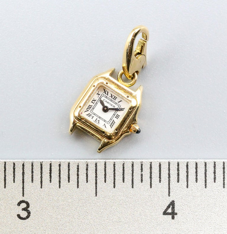 Fine and rare 18k yellow gold Panthere de Cartier watch charm by Cartier.  Hallmarks: Cartier, 750, reference numbers, French 18k gold assay marks, maker's mark.