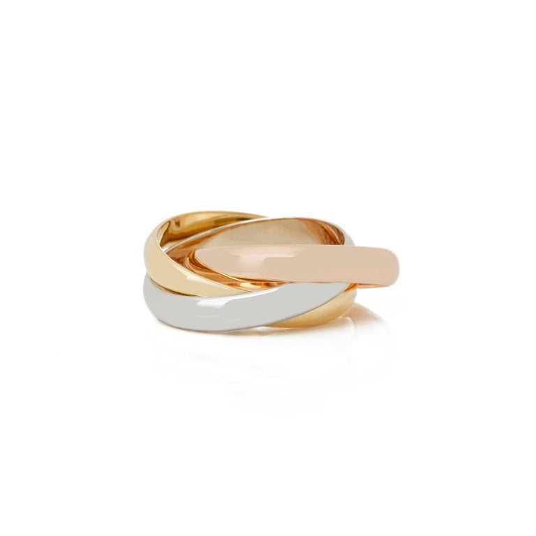 This Ring by Cartier is from their Trinity Collection and features Three Bands in 18k Yellow, White and Rose Gold. Ring Size UK M, EU Size 53, USA Size 6 1/2. Complete with Xupes Presentation Box. Our Xupes reference is COMJ209 should you need to