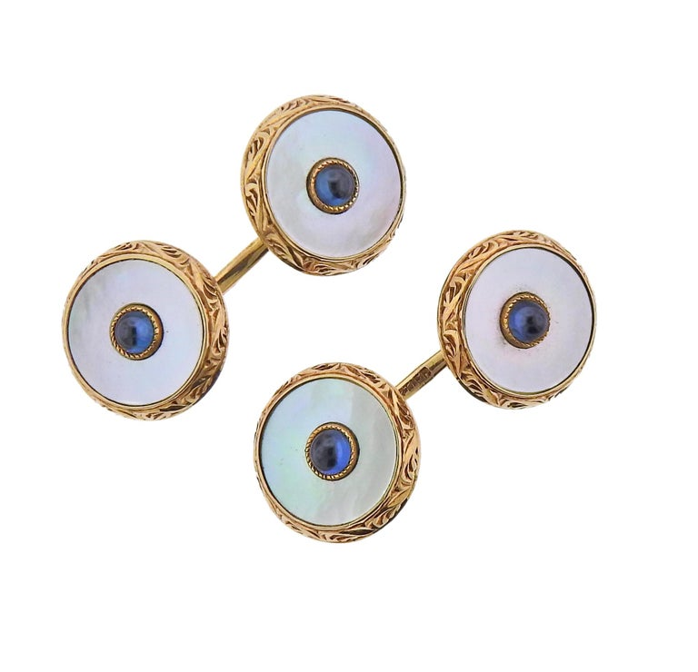 Art Deco Cartier cufflinks and studs set, in 14k gold and platinum top, with mother of pearl top and sapphire in the middle. Comes with original Cartier broken box.  Cufflink top is 15mm in diameter, largers stud - 15mm, small button - 8mm. Marked:
