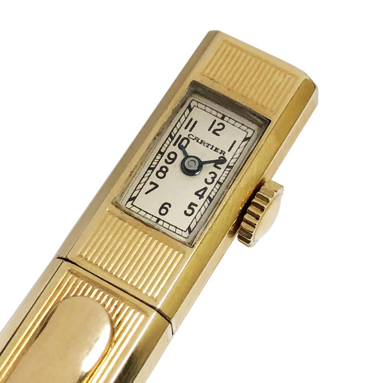 Circa 1940s Cartier 14K Yellow Gold Pencil, Watch measuring 5 1/8 inches in length and 7/16 inch wide, having an engraved ribbed design with Pocket clip. 17 jewel mechanical, manual wind Perry Watch Co. Movement, white dial with Black Arabic