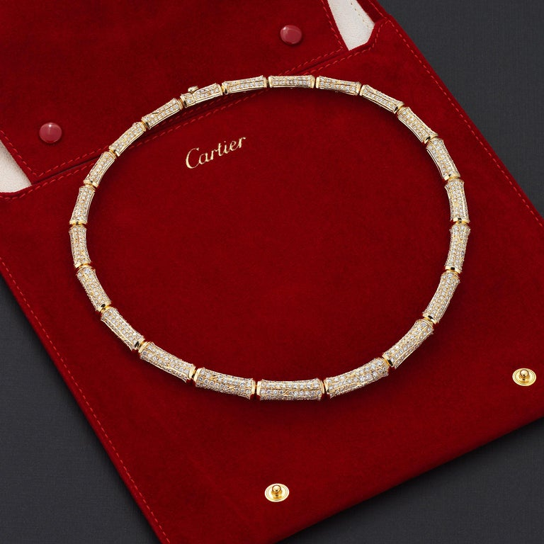 Dazzling vintage Cartier Bamboo necklace showcasing approximately 20 carats of fine-white brilliant round diamonds impeccably set in lustrous 18 karat yellow gold. The necklace rests effortlessly and comfortably on the collar, allowing for full