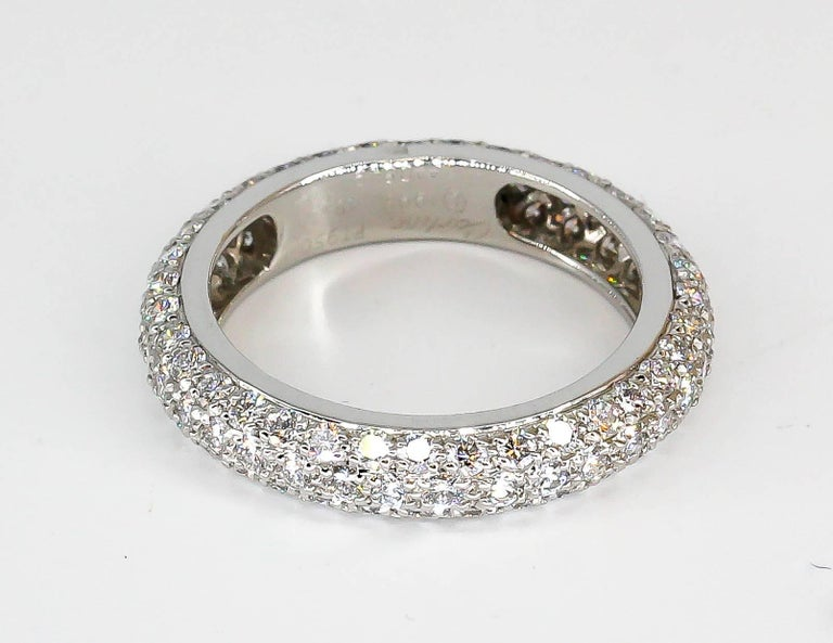Elegant 3 row pave diamond and platinum band by Cartier. It features high grade round brilliant cut diamonds in 3 rows. Approx. size 4.5-5 (European size 48)  Hallmarks: Cartier, 1995, PT 950, 48, reference numbers, maker's mark, platinum assay mark.