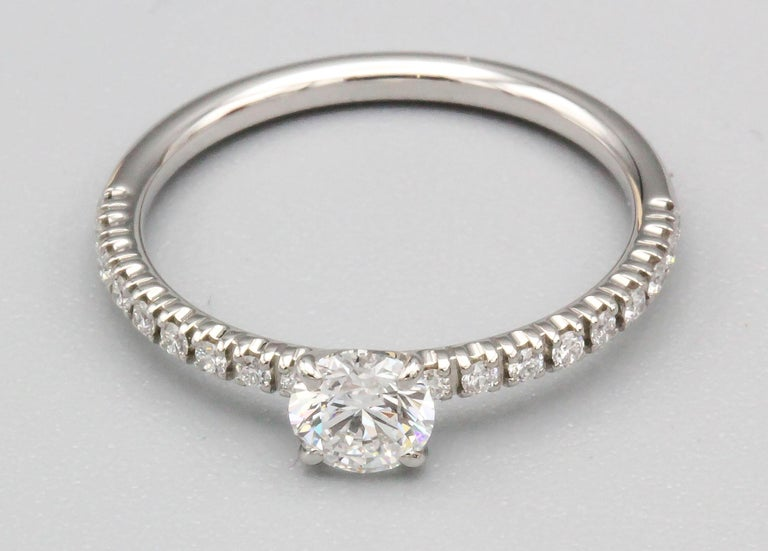 Cartier .30 Carat E VS1 Diamond and Platinum Engagement Ring For Sale 7