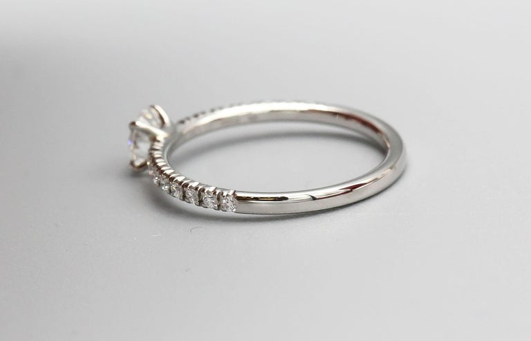 Cartier .30 Carat E VS1 Diamond and Platinum Engagement Ring In Excellent Condition For Sale In New York, NY