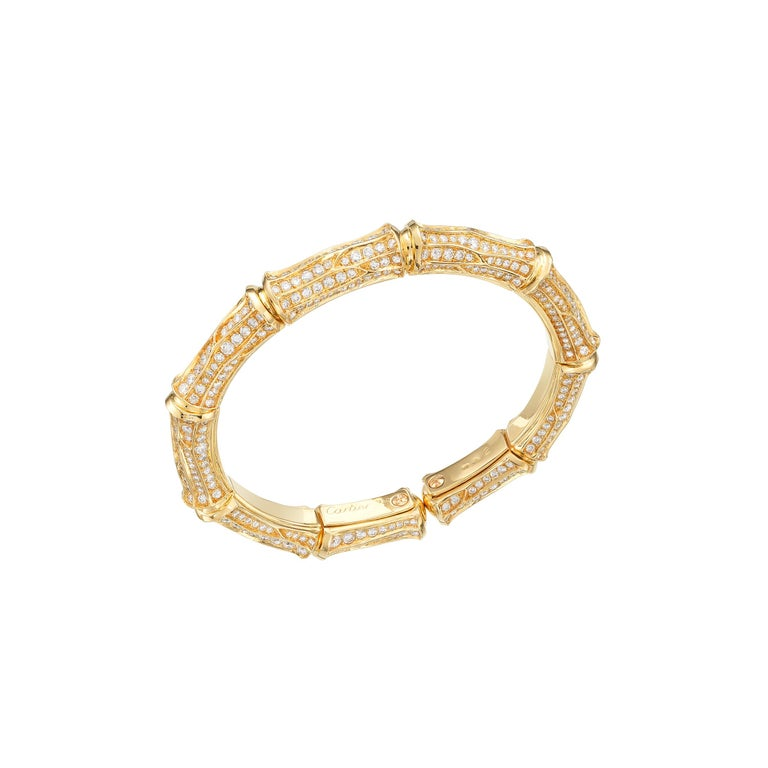Dazzling vintage Cartier Bamboo collection suite showcasing approximately 37 carats of fine-white brilliant round diamonds impeccably set in lustrous 18 karat yellow gold. The 4-item suite consists of a collar necklace, cuff bracelet, hoop earrings,