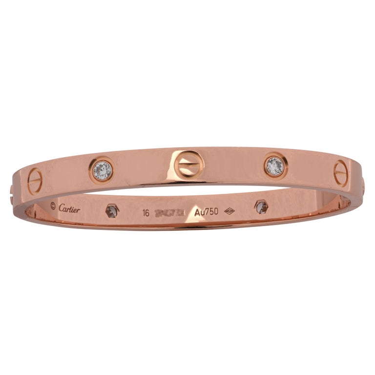 Cartier LOVE bracelet crafted in 18 Karat Rose Gold, featuring 4 round brilliant cut diamonds. The Cartier love collection has created a timeless tribute to the symbol of love that transcends through an iconic style originating from the 1970s. The