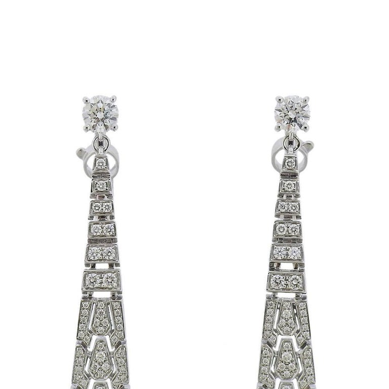 Pair of exquisite long drop earrings by Cartier, set with 7.8mm pearls and approx. 6.35ctw in diamonds. Come with Cartier Certificate and a pouch. Earrings are 4.25
