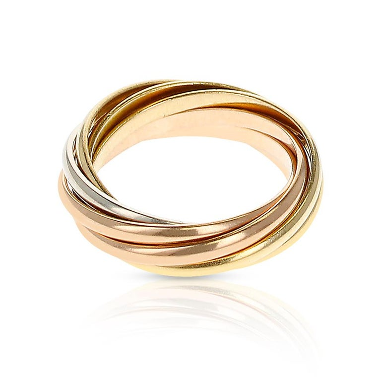 A Cartier 7 Band Rolling Ring made in 18 Karat Rose, White and Yellow Gold. Ring Size 5.50. Total Weight: 7 grams.