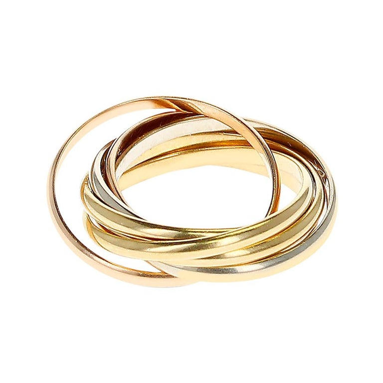 Cartier 7 Band Rolling Ring, 18 Karat Rose, White and Yellow Gold For Sale