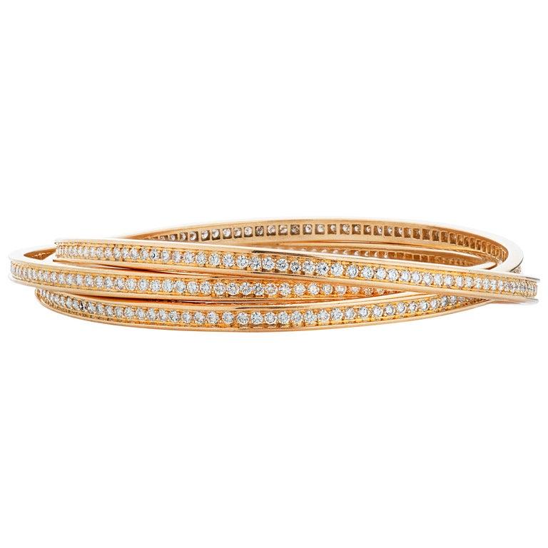 Cartier 7 Carat Diamond Trinity Rolling Bangle Bracelet in 18 Karat Yellow Gold For Sale