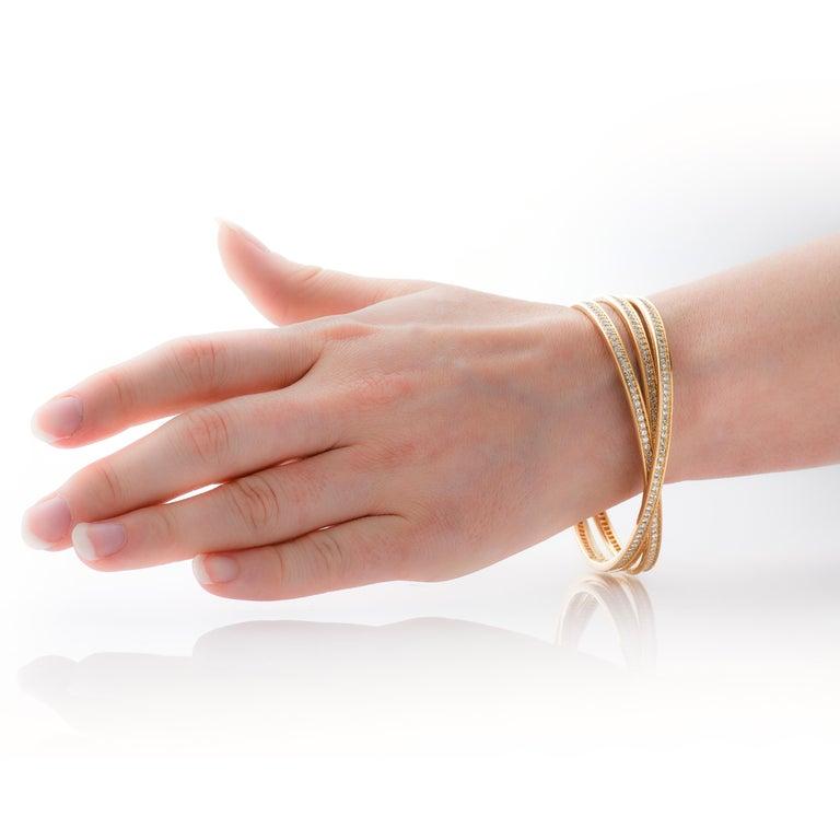 Cartier 7 Carat Diamond Trinity Rolling Bangle Bracelet in 18 Karat Yellow Gold In Good Condition For Sale In Philadelphia, PA