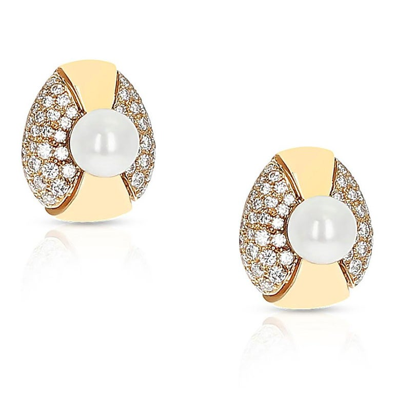 A beautiful pair Cartier 8MM Pearl and Diamond Oval-Shape Earrings made in 18 Karat Yellow Gold. The length is 0.65