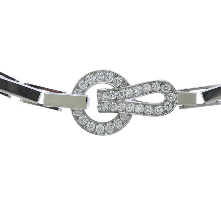 Classic  18k white gold Agrafe necklace by Cartier, adorned with approximately 1.36ctw in G/VS diamonds. Necklace is 16 3/4