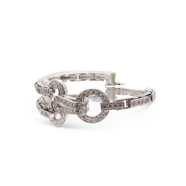 Round Cut Cartier 'Agrafe' White Gold Diamond Bracelet For Sale