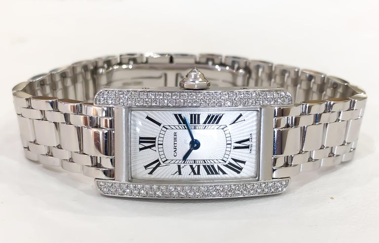 Lady's Cartier Small Americaine Diamond Tank 18K White Gold .85ctw comes with box, papers, extra link. All diamonds are factory set by Cartier.  •REFERENCE NO: 2489 •MOVEMENT: QUARTZ BATTERY •CASE MATERIAL: SOLID 18 KARAT WHITE GOLD •CONDITION: LIKE