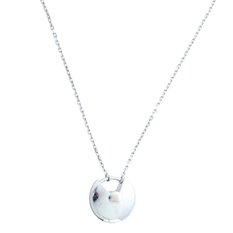 A magnificent offering from Cartier's Amulette de Cartier line. The necklace comes crafted using 18k white gold and it has the signature motif skillfully detailed with shimmering diamonds weighing approximately 0.25 carats. Smoothly finished, the