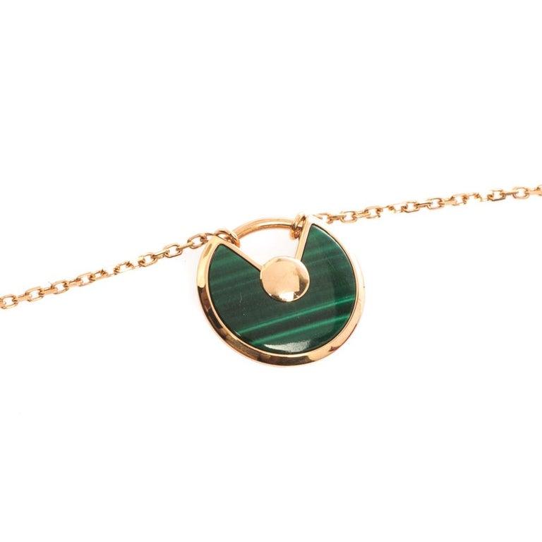 Cartier Amulette De Cartier Malachite 18k Rose Gold XS Pendant Necklace In Good Condition For Sale In Dubai, Al Qouz 2