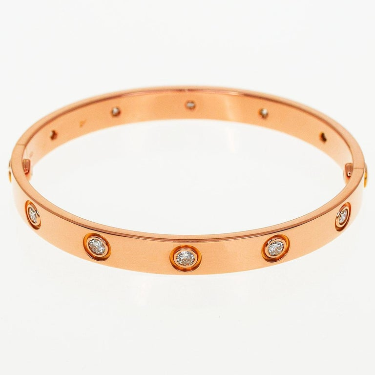 Brand:Cartier Name:Anniversary 150 years Limited 300 Full Diamonds Love bracelet 16cm Material:10P diamond, K18 750 PG Pink Gold Weight:29.1g(Approx) Band length(inch):16cm / 6.29in(Approx) Width(inch) :6.27mm / 0.24in(Approx) Comes with:Cartier