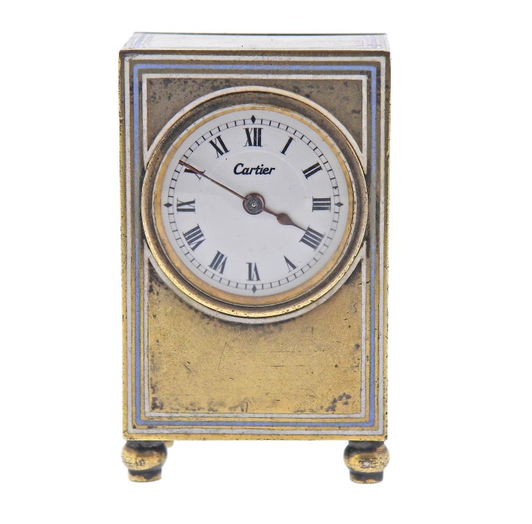 Antique Cartier sterling silver desk/travel clock with original key winder and box. Clock measures 1.75