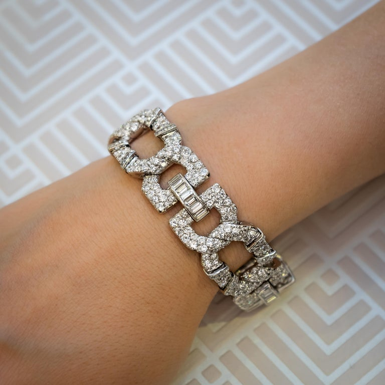An Art Deco diamond bracelet by Cartier, mounted in platinum, with round brilliant-cut and old-cut diamonds in pavé settings and square-cut and baguette-cut diamonds in channel settings. Signed Cartier, numbered 61603, 905421 and 1520, French dog