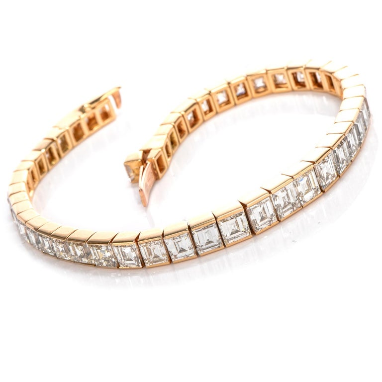 This elegant 1980's Cartier line bracelet has channelled High qiality Asscher Cut Dimaonds throughout with a slight taper from center to ends and contains a hidden lockingcatch with safety. The diamonds weigh approximately approximately 24.00 carats