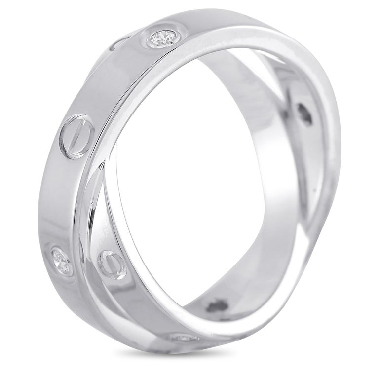 Celebrate a love that has survived twists and turns with this Cartier Astro Love Ring. Forged in 18K white gold, this double ring that twists and turns features a diamond-and-screw motif around its outer edge. The simple yet elegant style is perfect