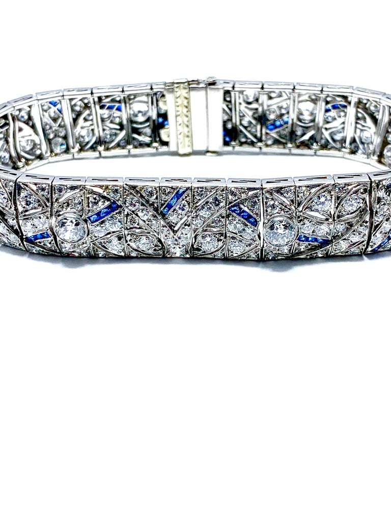An exquisite Art Deco Diamond and Sapphire bracelet.  Each link is handcrafted down to every last detail.  The old European cut Diamonds dominate throughout the bracelet, with square cut sapphires adding highlights.  The Diamonds have a total weight