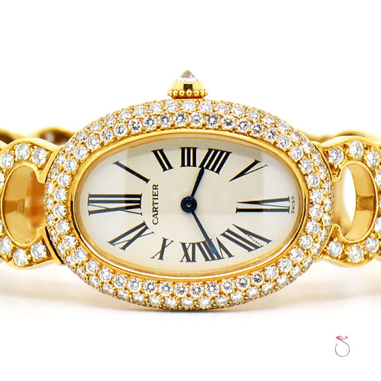 100% All Original, Extremely rare and Magnificent ladies Cartier Baignoire full diamond watch in 18K yellow gold. This gorgeous watch features the oval baignoire case in 18k white gold set with three rows of  diamonds covering the case, the 140