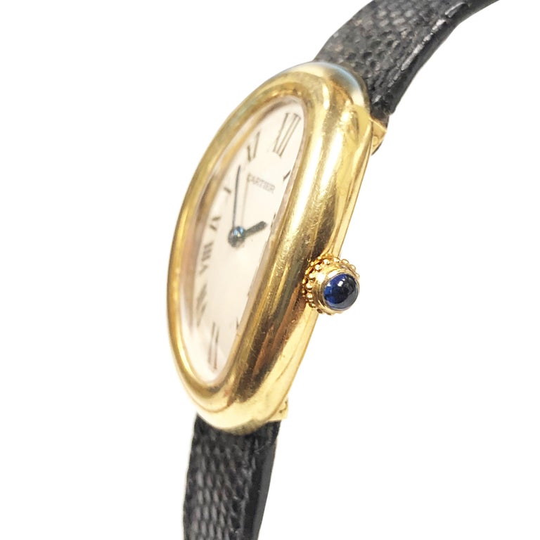 Circa 1980 Cartier Baignoire collection Wrist watch owned and worn by Hollywood Icon Jerry Lewis. 31 X 23 MM 18K Yellow Gold 2 Piece water resistant case. Quartz Movement, White dial with Black Roman numerals. Black Lizard Strap with Gold Plate