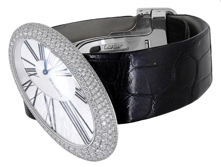 """CARTIER Baignoire Hypnose Diamond Pearl Watch in 18k White Gold.  A very rare timepiece from the house of Cartier, this watch features an oval """"baignoire"""" casing with a luminescent and finely engraved face. The bezel is peppered with white diamond"""