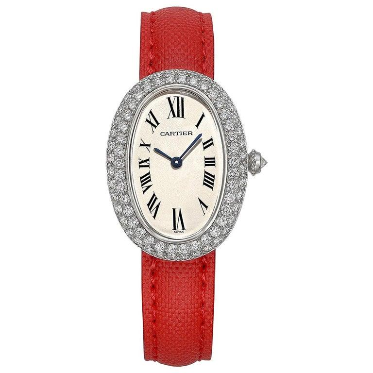 Pre-owned Cartier Baignoire wristwatch, featuring a Swiss-made quartz movement; silver dial with black Roman numerals; and 30 x 25mm 18k white gold case set with two rows of graduated round-cut diamonds on a Cartier red leather strap secured by the