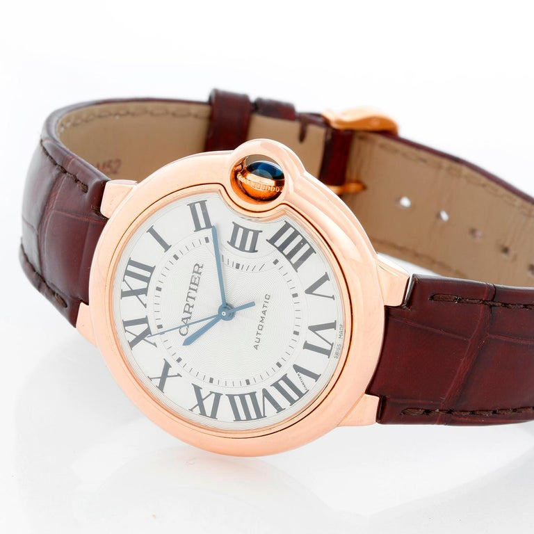 Cartier Ballon Bleu 18K Rose Gold Ladies Midsize Watch WGBB0009 - Automatic winding. 18k Rose gold  case (36 mm ). Silver guilloche dial with black Roman numerals. Brown strap. Pre-owned  with Cartier box .