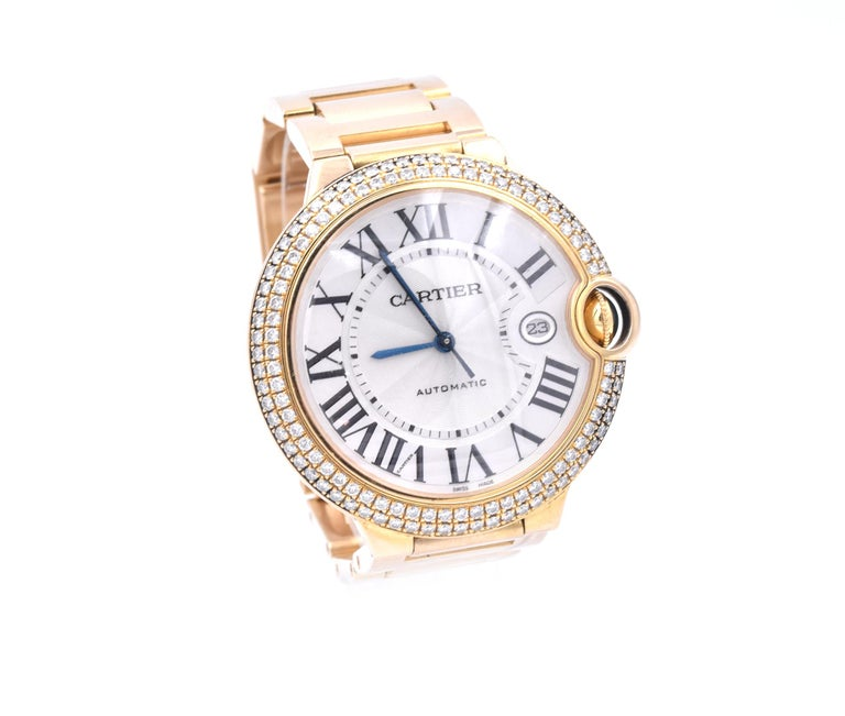 Movement: automatic  Function: hours, minutes, seconds, date Case: 42mm yellow gold case, pave diamond bezel, cabochon sapphire push/pull crown, sapphire crystal Dial: white dial, roman numeral hour markers, blue hands Band: Cartier yellow gold