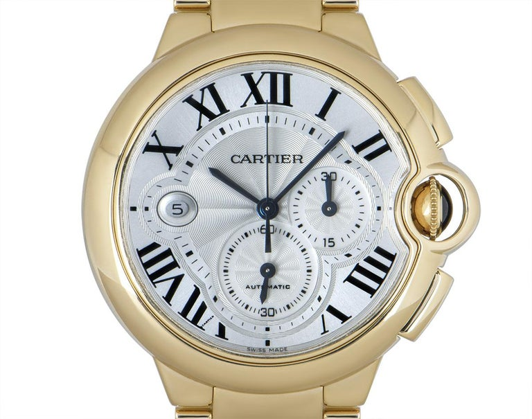 A 47 mm Ballon Bleu in yellow gold by Cartier. Featuring a silver guilloche dial concealed by sapphire crystal, with Roman numerals, sword-shaped hands in blued steel and a secret Cartier signature at V of VII. A small seconds display and a 30