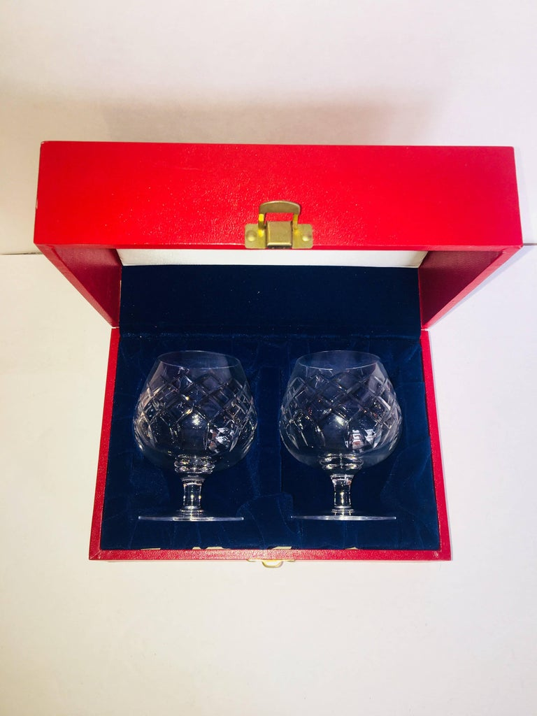 Vintage Cartier brandy snifters in original box with metal clasp and velvet interior. Pair of two etched crystal brandy snifters measuring 4.5