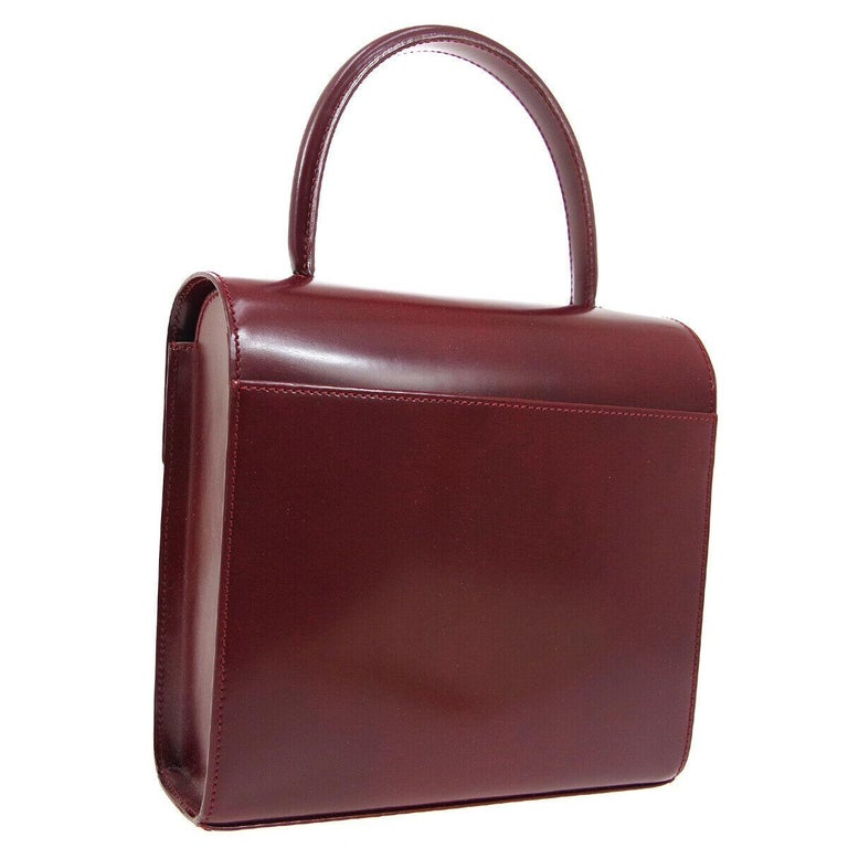 Cartier Burgundy Patent Leather Silver Emblem Kelly Style Top Handle Satchel Bag In Good Condition In Chicago, IL