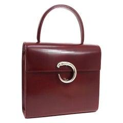 Cartier Burgundy Patent Leather Silver Emblem Kelly Style Top Handle Satchel Bag
